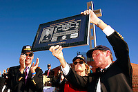 Saturday, November 8, 2008, Mt. Soledad Veterans Memorial La Jolla California.  The President of the  Mount Soledad Monument Association, William J. Kellogg, holds a plague honoring Brigadier General James Maitland Stewart aloft.  Stewart, a highly decorated United States Air Force, WWII pilot and highly acclaimed Hollywood actor was honored with a special plaque during at a dedication ceremony attended by his daughter (Kelly Stewart Harcout, center) and Michael McLean, (left) another family member.