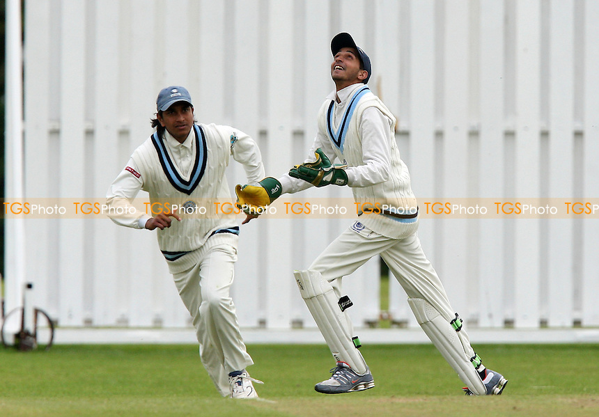 T Shazad of GPR (R) celebrates his catch to dismiss M Thurston off of the bowling of S Kingston - Gidea Park & Romford CC vs Chelmsford CC - Essex Cricket League - 09/05/09 - MANDATORY CREDIT: Gavin Ellis/TGSPHOTO - Self billing applies where appropriate - 0845 094 6026 - contact@tgsphoto.co.uk - NO UNPAID USE.