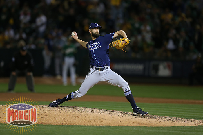 OAKLAND, CA - OCTOBER 02:  Nick Anderson #70 of the Tampa Bay Rays pitches against the Oakland Athletics during the American League Wild Card Game at RingCentral Coliseum on Wednesday, October 2, 2019 in Oakland, California. (Photo by Brad Mangin)