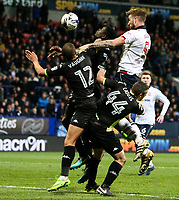 Bolton Wanderers' Mark Beevers jumps with Bury's James Vaughan, Paul Caddis and Leon Barnett<br /> <br /> Photographer Alex Dodd/CameraSport<br /> <br /> The EFL Sky Bet League One - Bolton Wanderers v Bury - Tuesday 18th April 2017 - Macron Stadium - Bolton<br /> <br /> World Copyright &copy; 2017 CameraSport. All rights reserved. 43 Linden Ave. Countesthorpe. Leicester. England. LE8 5PG - Tel: +44 (0) 116 277 4147 - admin@camerasport.com - www.camerasport.com