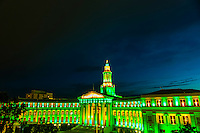The City and County Building illuminated for the Independence Eve fireworks show, Civic Center Park, Denver, Colorado USA