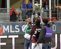 Kosuke Kimura #27 is filmed with the trophy from front and back During post game trophy Celebration after MLS Cup 2010 at BMO Stadium in Toronto, Ontario on November 21 2010.