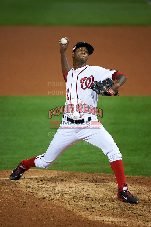 Salt River Rafters pitcher Abel De Los Santos (71) delivers a pitch during an Arizona Fall League game against the Glendale Desert Dogs on October 22, 2015 at Salt River Fields at Talking Stick in Scottsdale, Arizona.  Glendale defeated Salt River 7-5.  (Mike Janes/Four Seam Images)
