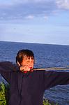 ATBK02 Boy firing his catapult into the sea