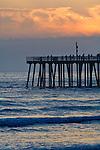 Sunset light over the pier and ocean waves at Pismo Beach, San Luis Obispo County coast, California