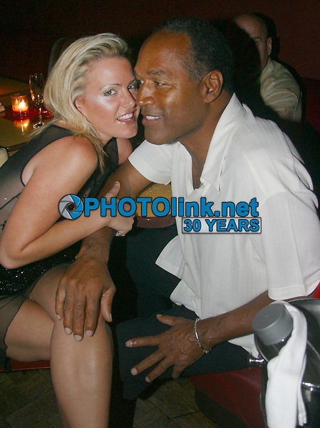OJ Simpson with girlfriend Christy Prody<br /> 2002<br /> Photo By Adam Scull/CelebrityArchaeology.com