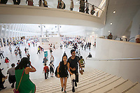 Thousands of visitors pack the World Trade Center Transportation Hub, known as the Oculus, on Tuesday, August 16, 2016 for the grand opening of the retail spaces. The 350,000 square foot retail space will feature over 100 stores when they all open, including a now opened Apple Store. The mall opens almost 15 years after the World Trade Center terrorist attack.  (© Richard B. Levine)