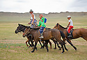 Children riding horses Mongolia