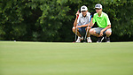 Austin Jacobs (left) of the Whitmoor Country Club and his friend Owen Sanders of the Old Hickory Golf Club line up their putts on the third green on the first day of the Metropolitan Amateur Golf Association's 20th Junior Amateur Championship being held at the St. Clair Country Club in Belleville, IL on July 1, 2019. <br /> Tim Vizer/Special to STLhighschoolsports.com