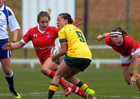 Cobie-Jane Morgan tries to evade the oncoming Lori Josephson during the 2017 International Women's Rugby Series rugby match between Canada and Australia Wallaroos at Smallbone Park in Rotorua, New Zealand on Saturday, 17 June 2017. Photo: Dave Lintott / lintottphoto.co.nz
