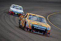 Nov. 9, 2008; Avondale, AZ, USA; NASCAR Sprint Cup Series driver Matt Kenseth (17) leads Greg Biffle during the Checker Auto Parts 500 at Phoenix International Raceway. Mandatory Credit: Mark J. Rebilas-