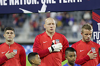 WASHINGTON, D.C. - OCTOBER 11: Christian Pulisic #10, Brad Guzan #1 and Jackson Yueill #14 of the United States during the national anthem prior to their Nations League game versus Cuba at Audi Field, on October 11, 2019 in Washington D.C.