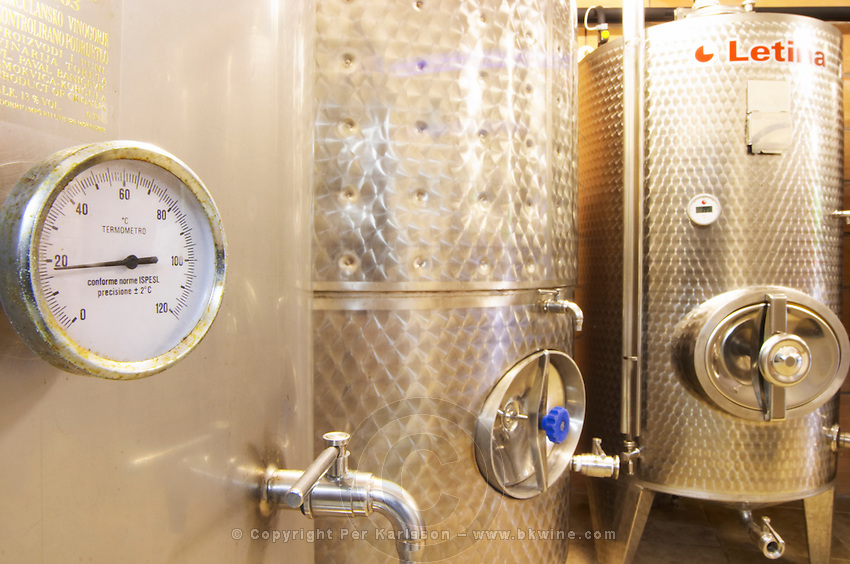 The winery with modern stainless steel fermentation tanks. Detail of tank thermometer showing 17 degrees centigrade. Toreta Vinarija Winery in Smokvica village on Korcula island. Vinarija Toreta Winery, Smokvica town. Peljesac peninsula. Dalmatian Coast, Croatia, Europe.