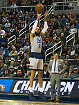 Nevada's Cody Martin (11) shoots a three pointer as South Dakota State head coach T.J. Otzelberger looks on in the first half of an NCAA college basketball game in Reno, Nev., Saturday, Dec. 15, 2018. (AP Photo/Tom R. Smedes)