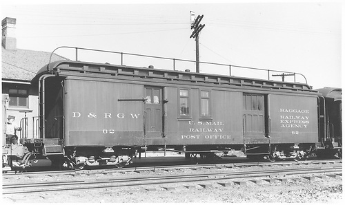 #62 baggage &amp; mail car at Antonito.  Side view.  Hand rail on roof.<br /> D&amp;RGW  Antonito, CO  Taken by Best, Gerald M. - 7/23/1940