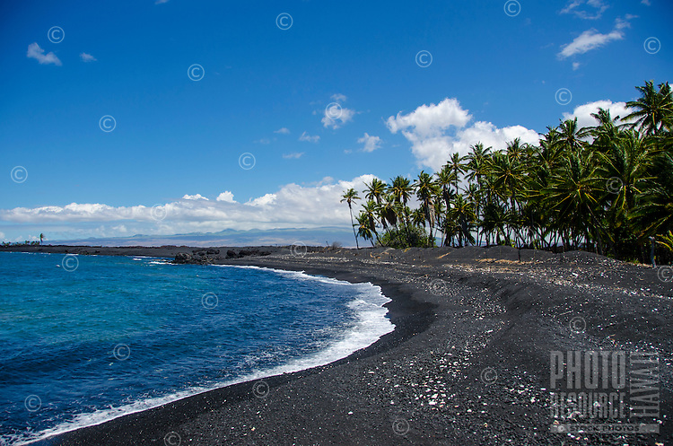 Looking north along the mostly black sand beach of Keawaiki Bay, north of Kona, Hawai'i Island; an 1859 eruption of Mauna Loa flowed into this area, which was also the site of an ancient Hawaiian settlement and temple (or heiau).