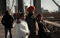 An Indian family poses for a picture at the brooklyn bridge in New York, United States. 11/01/2012. Officials announced the arrival of the record-breaking 50 millionth visitor of the year. Photo by Kena Betancur / VIEWpress.
