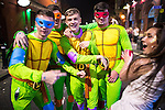 © Joel Goodman - 07973 332324 . 27/12/2016 . Wigan , UK . Four men wearing Teenage Mutant Ninja Turtles themed outfits . Revellers in Wigan enjoy Boxing Day drinks and clubbing in Wigan Wallgate . In recent years a tradition has been established in which people go out wearing fancy-dress costumes on Boxing Day night . Photo credit : Joel Goodman