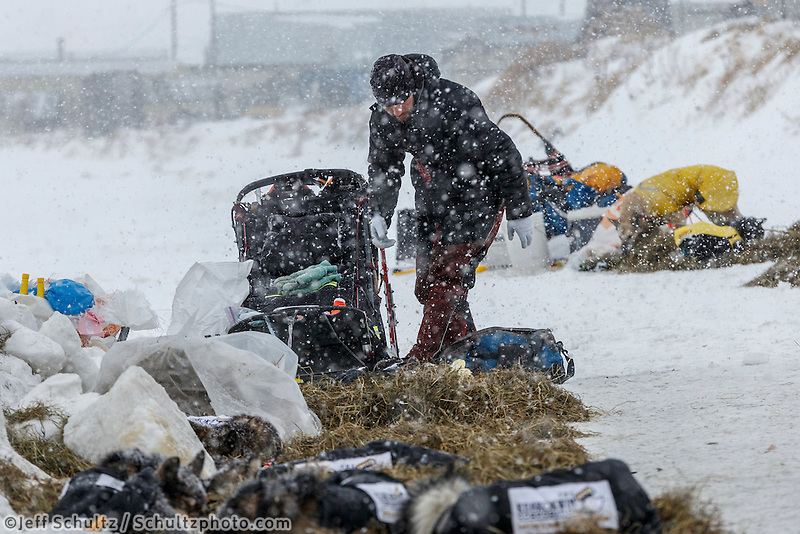 Richie Diehl unpacks after his arrival at the Unalakleet checkpoint on Monday March 16, 2015 during Iditarod 2015.  <br /> <br /> (C) Jeff Schultz/SchultzPhoto.com - ALL RIGHTS RESERVED<br />  DUPLICATION  PROHIBITED  WITHOUT  PERMISSION