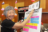 OrigamiUSA 2014. Patsy Wang-Iverson announces classes in the hospitality room.