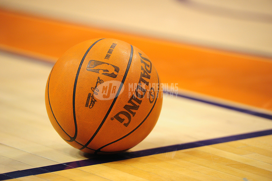 Dec. 26, 2011; Phoenix, AZ, USA; Detailed view of a Spalding official basketball on the court during the game between the New Orleans Hornets against the Phoenix Suns at the US Airways Center. The Hornets defeated the Suns 85-84. Mandatory Credit: Mark J. Rebilas-USA TODAY Sports