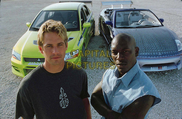 PAUL WALKER and TYRESE.  .Film Title: 2 Fast 2 Furious.  .Filmstill - Editorial Use Only.Ref: FB.sales@capitalpictures.com.www.capitalpictures.com.Supplied by Capital Pictures.