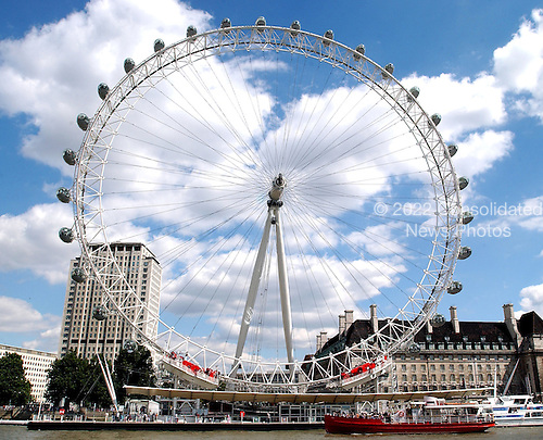 "London, Great Britain - August 7, 2005 -- The ""London Eye"" as seen from a ferry in the Thames River in London, Great Britain on August 7, 2005.  For a nominal fee, the ""London Eye"" provides spectacular views up and down the Thames as it moves slowly around in a circle..Credit: Ron Sachs / CNP"