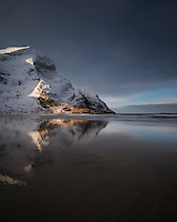 Winter mountain reflection on Bunes beach, Moskenesøy, Lofoten Islands, Norway