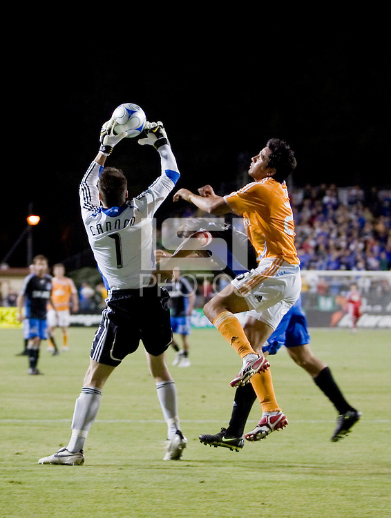 San Jose goalie, Joe Cannon saves the ball over Houston's Brian Ching. San Jose Earthquakes 2, Houston Dynamo 1. Buck Shaw Stadium, California. Thursday, May 22, 2008.