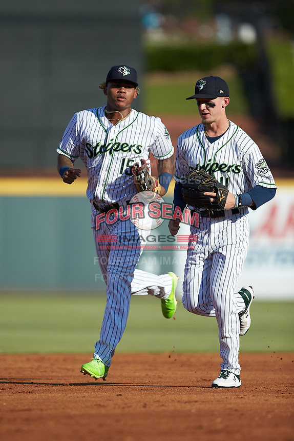 Gwinnett Stripers outfielders Cristian Pache (15) and Drew Waters (11) jog off the field between innings of the game against the Scranton/Wilkes-Barre RailRiders at BB&T BallPark on August 17, 2019 in Lawrenceville, Georgia. The Stripers defeated the RailRiders 8-7 in eleven innings. (Brian Westerholt/Four Seam Images)