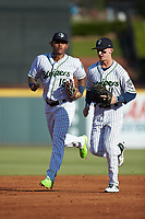 Gwinnett Stripers outfielders Cristian Pache (15) and Drew Waters (11) jog off the field between innings of the game against the Scranton/Wilkes-Barre RailRiders at Coolray Field on August 17, 2019 in Lawrenceville, Georgia. The Stripers defeated the RailRiders 8-7 in eleven innings. (Brian Westerholt/Four Seam Images)