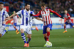 Atletico de Madrid´s Antoine Griezmann and Real Sociedad´s Alberto de la Bella (L) during 2015-16 La Liga match between Atletico de Madrid and Real Sociedad at Vicente Calderon stadium in Madrid, Spain. March 01, 2016. (ALTERPHOTOS/Victor Blanco)