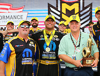Sep 5, 2016; Clermont, IN, USA; NHRA funny car driver Matt Hagan (center) celebrates with crew chief Dickie Venables (left) and father David Hagan after winning the US Nationals at Lucas Oil Raceway. Mandatory Credit: Mark J. Rebilas-USA TODAY Sports
