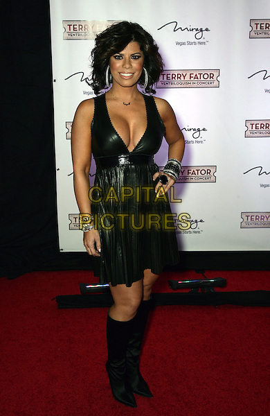 ELENA MACHINE .Terry Fator Celebrates Star-Studded One Year Anniversary at The Mirage Resort Hotel and Casino, Las Vegas, Nevada, USA.  .March 13th, 2010.full length black leather jacket low cut neckline cleavage hand on hip bracelets boots.CAP/ADM/MJT.© MJT/AdMedia/Capital Pictures.