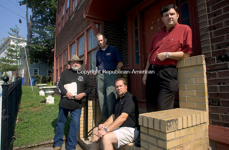WATERBURY, CT- 28 JULY 2008- 072808JT01-<br /> From right, St. Joseph parishioners Jerry Covino, Linas Balsys, Peter Verseckas, and Gary McGuire, pictured at their church's rectory, are fighting for the rectory to remain.<br /> Josalee Thrift / Republican-American