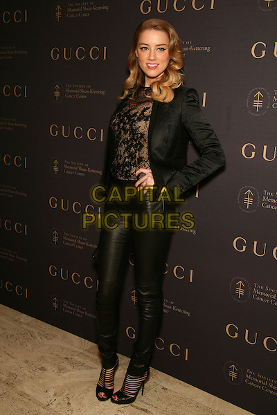 AMBER HEARD .attend The Society of Memorial Sloan-Kettering Cancer Center's Annual Fall Party at the Four Seasons Restaurant, New York, NY, USA, .November 16th, 2010.full length black jacket hand on hip lace top trousers blazer peep toe shoes ankle boots sandals beige sheer see thru through .CAP/LNC.©TOM/LNC/Capital Pictures.