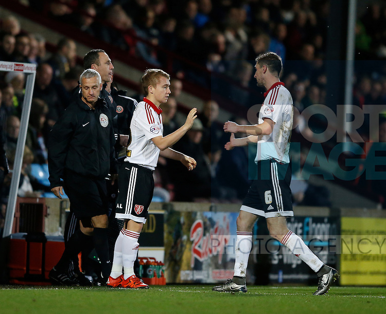 Chris Basham of Sheffield Utd comes off and is replaced by Louis Reed of Sheffield Utd - English League One - Scunthorpe Utd vs Sheffield Utd - Glandford Park Stadium - Scunthorpe - England - 19th December 2015 - Pic Simon Bellis/Sportimage