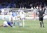 Ross Campbell (6) getting a yellow card from Referee Greg Aitken for a foul on Jordan Marshall (on the ground) in the SPFL Ladbrokes Championship Play Off semi final match between Queen of the South and Montrose at Palmerston Park, Dumfries on  11.5.19.