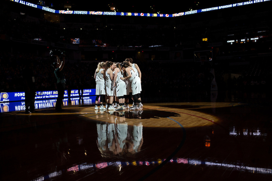 Penn players huddle before the start of the IHSAA Class 4A Girls Basketball State Championship Game on Saturday, Feb. 27, 2016, at Bankers Life Fieldhouse in Indianapolis.