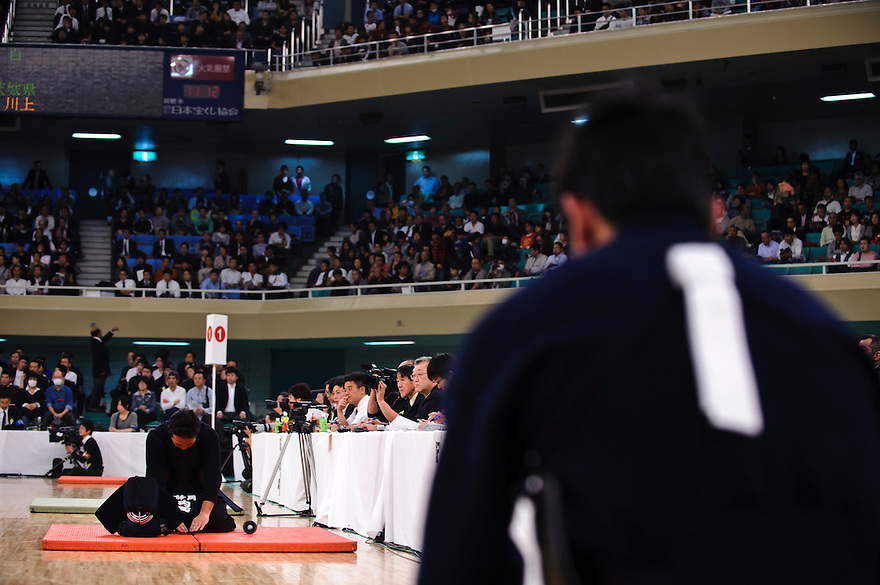 Contestants bowing after a bout at the 59th All Kendo Championship,  Budokan, Tokyo, Japan, November 3, 2011. Contestants from all over Japan compete doing the day-long event. Kendo is a popular martial art based on traditional Japanese swordsmanship.