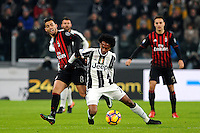 Calcio, quarti di finale di Tim Cup: Juventus vs Milan. Torino, Juventus Stadium, 25 gennaio 2017.<br /> Juventus' Juan Cuadrado, center, is challenged by AC Milan's Suso, left, during the Italian Cup quarter finals football match between Juventus and AC Milan at Turin's Juventus stadium, 25 January 2017.<br /> UPDATE IMAGES PRESS/Manuela Viganti