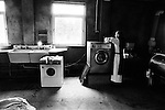 A monk working in the laundry at Sancta Maria Abbey at Nunraw, East Lothian, home since 1946 to the Order of Cistercians of the Strict Observance. Around 15 monks were resident at Nunraw in 1996, undertaking a mixture of daily tasks and strict religious observance. The present purpose-built building dates from 1969 when the monks moved from the nearby Nunraw house.
