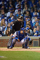 Umpire John Hirschbeck and Chicago Cubs catcher Willson Contreras (40) in the first inning during Game 3 of the Major League Baseball World Series against the Cleveland Indians on October 28, 2016 at Wrigley Field in Chicago, Illinois.  (Mike Janes/Four Seam Images)