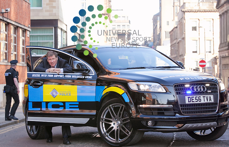 Justice secretary Kenny MacAskill, and assistant Chief John Neilson, with recently seized proceeds of crime high performance car, Pitt St Strathclyde Police head quarters Glasgow.Picture Credit / Johnny Mclauchlan/Universal News and Sport, Scotland/08/03/10....