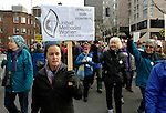 "Carol Jaeger, a member of United Methodist Women at Haller Lake United Methodist Church in Seattle, was among hundreds of Seattle residents who marched from Westlake Center Park to the Seattle Center on January 13, 2013, calling for stricter regulations of firearms. Sponsored by a network of churches and other groups called ""Stand-up Washington,"" the demonstrators called for a state ban on semi-automatic weapons as well as stricter gun laws."