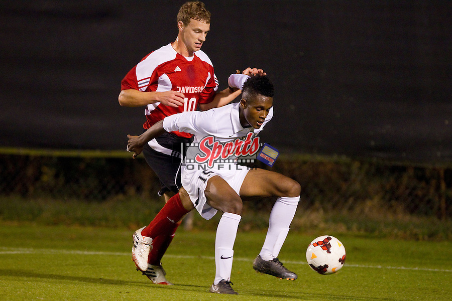 Jalen Robinson (15) of the Wake Forest Demon Deacons keeps the ball away from Alec Rotunda (10) of the Davidson Wildcats at Spry Soccer Stadium on October 22, 2013 in Winston-Salem, North Carolina.  The Demon Deacons defeated the Wildcats 4-0.  (Brian Westerholt/Sports On Film)