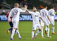 CARSON, CA - March 17, 2012: Vancouver Whitecaps FC players Eric Hassli (29) and Davide Chiumiento (20) celebrating their goal during the Chivas USA vs Vancouver Whitecaps FC match at the Home Depot Center in Carson, California. Final score Vancouver Whitecaps 1, Chivas USA 0.