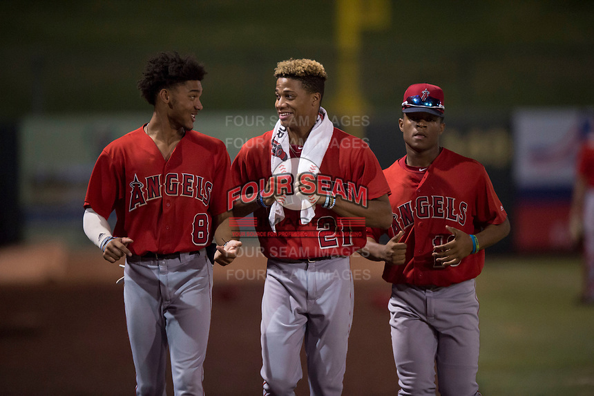 Los Angeles Angels 2018 draft picks Jeremiah Jackson (8), Jordyn Adams (21), and Datren Bray (16) walk towards the dugout between innings of an Arizona League game between the AZL Angels and the AZL Athletics at Tempe Diablo Stadium on June 26, 2018 in Tempe, Arizona. The AZL Athletics defeated the AZL Angels 7-1. Adams was selected in the first round, Jackson in the second round, and Bray in the 19th round. (Zachary Lucy/Four Seam Images)