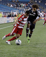 New England Revolution defender Kevin Alston (30) and FC Dallas forward David Ferreira(10) battle for possession of the ball near the New England goal.  The New England Revolution drew FC Dallas 1-1, at Gillette Stadium on May 1, 2010