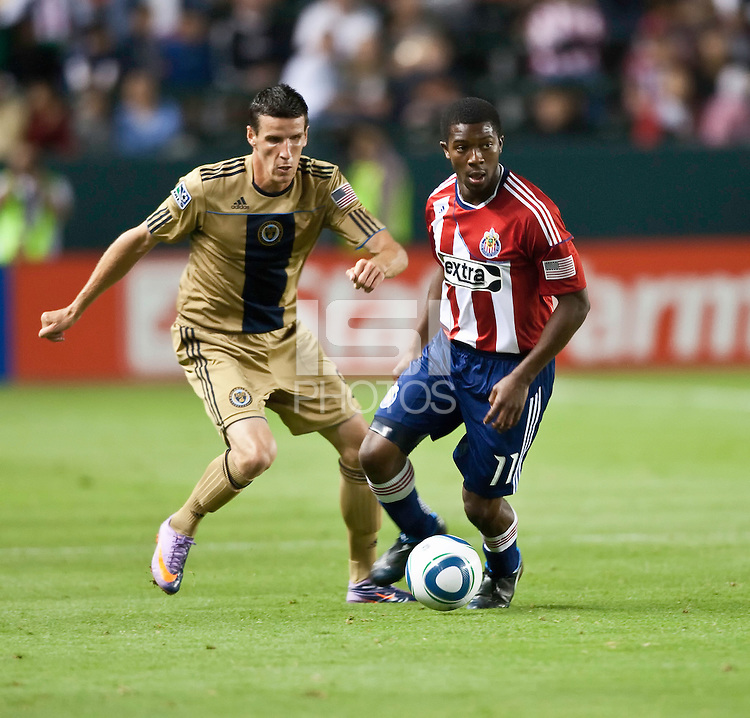 Chivas USA midfielder Michael Lahoud (11) moves the ball past Philadelphia Union forward Sebastien Le Toux (9) during the second half of the game between Chivas USA and the Philadelphia Union at the Home Depot Center in Carson, CA, on July 3, 2010. Chivas USA 1, Philadelphia Union 1.